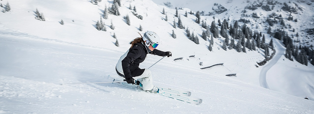 head skis + head goggles + ski jacket