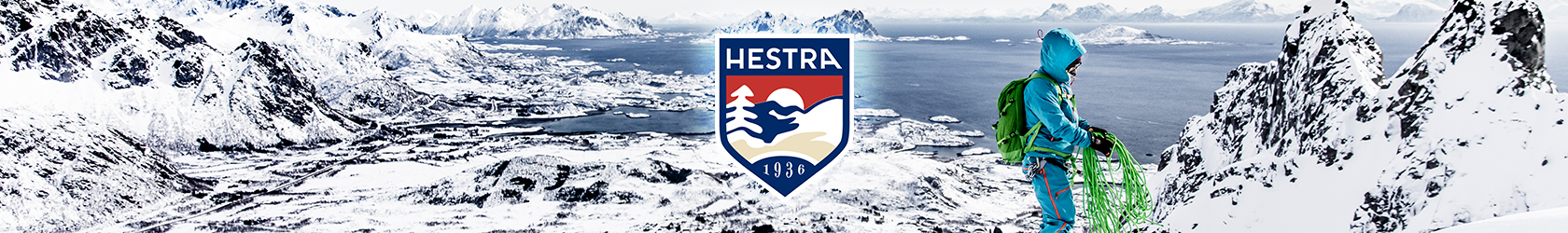 A person, wearing Hestra gloves, is preparing to climb snow mountains.