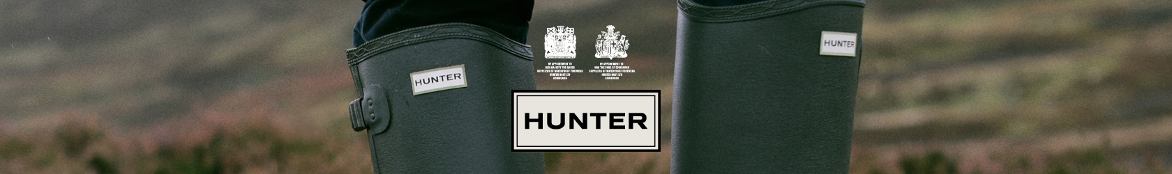 Green Hunter wellies with the Hunter logo in the middle of the image.